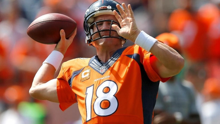 Denver Broncos quarterback Peyton Manning warms up prior to an NFL football game against the Kansas City Chiefs, Sunday, Sept. 14, 2014, in Denver. (AP Photo/Jack Dempsey)