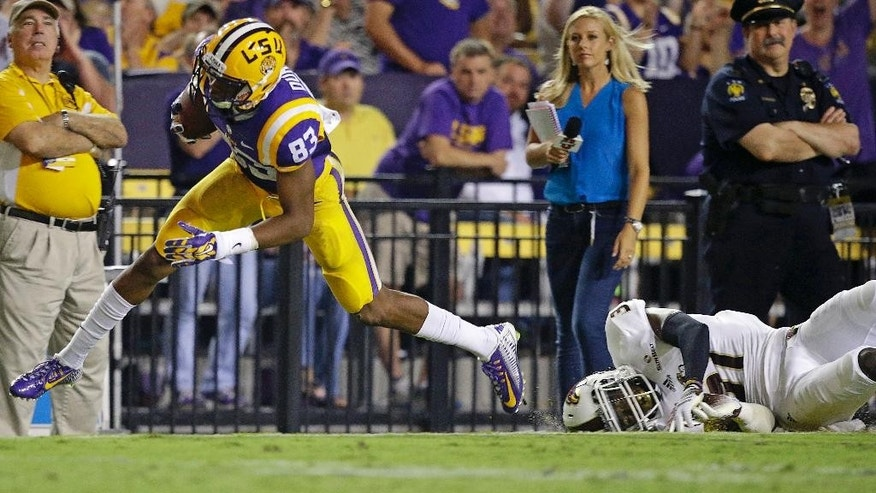 LSU wide receiver Travin Dural (83) pulls in a pass in front of Louisiana-Monroe cornerback Lenzy Pipkins during the second half of an NCAA college football game in Baton Rouge, La., Saturday, Sept. 13, 2014. LSU won 31-0. (AP Photo/Gerald Herbert)