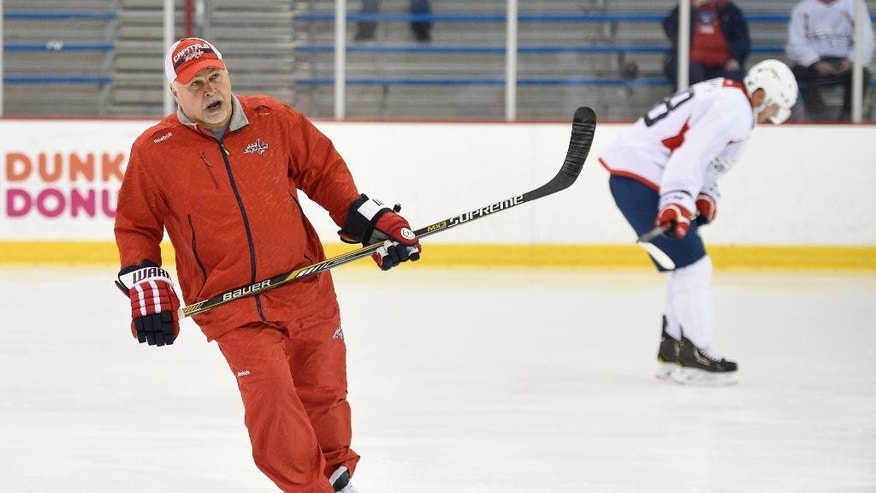 Washington Capitals head coach Barry Trotz skates on the ice during NHL hockey training camp, Friday, Sept. 19, 2014, in Arlington, Va. (AP Photo/Nick Wass)