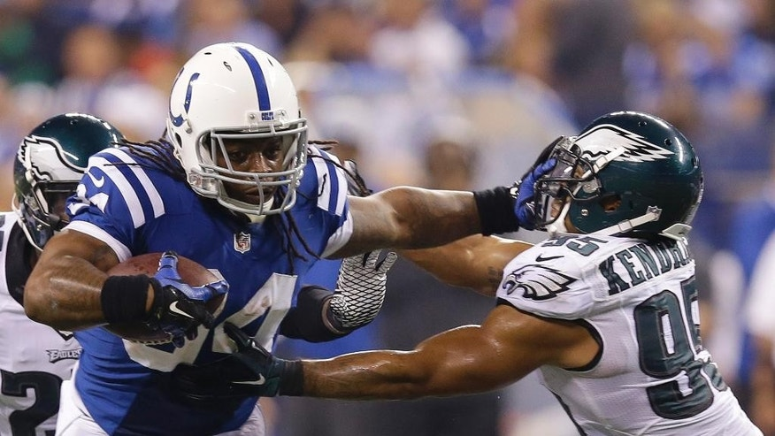 Indianapolis Colts running back Trent Richardson (34) runs past Philadelphia Eagles inside linebacker Mychal Kendricks (95) during the first half of an NFL football game Monday, Sept. 15, 2014, in Indianapolis. (AP Photo/Michael Conroy)