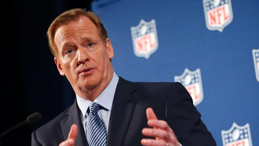 NFL Commissioner Roger Goodell speaks during a news conference Friday, Sept. 19, 2014, in New York. Goodell says the NFL wants to implement new personal conduct policies by the Super Bowl. The league has faced increasing criticism that it has not acted quickly or emphatically enough concerning the domestic abuse cases.   (AP Photo/Jason DeCrow)