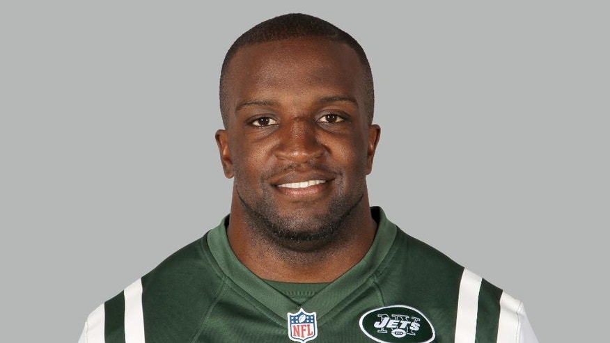 FILE - In this June 16, 2014, file photo, New York Jets' David Harris poses in an NFL football jersey in Florham Park, N.J. Harris is one of the most reluctant and least flashy star players this area has seen in recent years. (AP Photo/File)