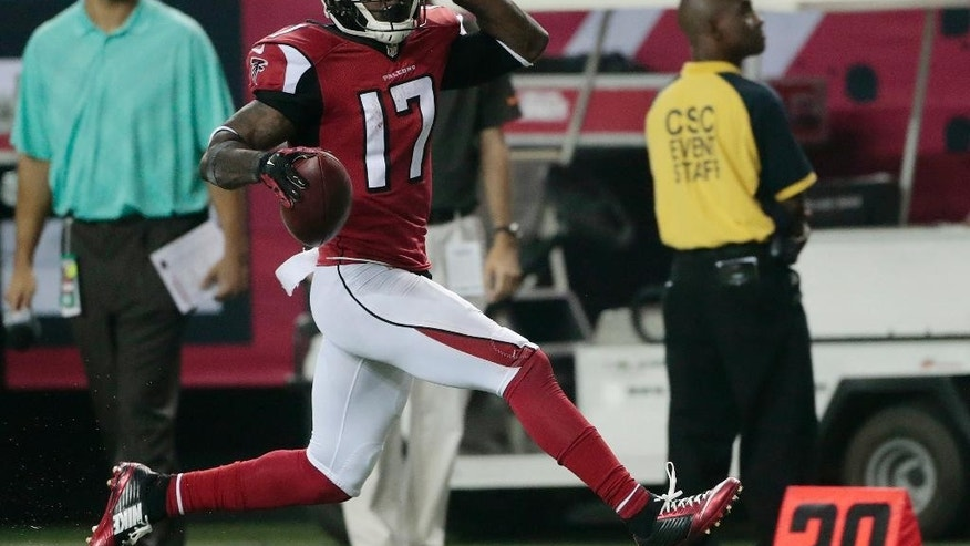Atlanta Falcons wide receiver Devin Hester (17) moves into the end zone for a touchdown against the Tampa Bay Buccaneers during the first half of an NFL football game, Thursday, Sept. 18, 2014, in Atlanta. (AP Photo/John Bazemore)