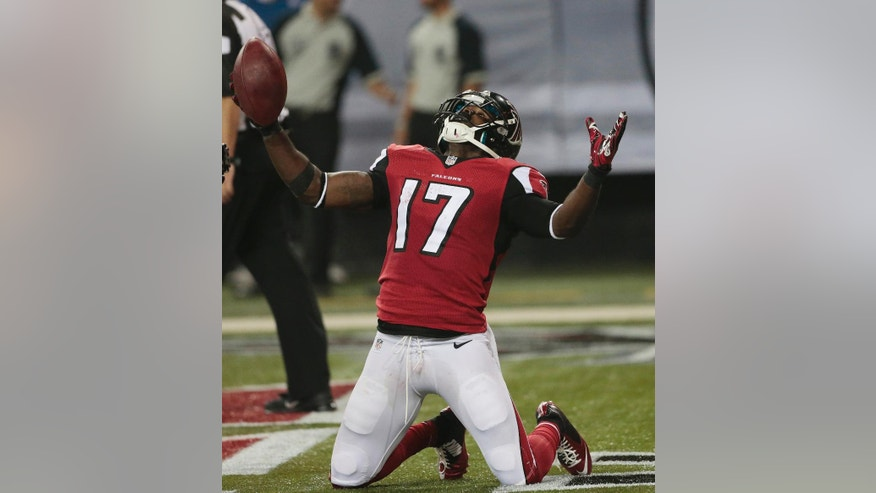 Atlanta Falcons wide receiver Devin Hester (17) celebrates his touchdown against the Tampa Bay Buccaneers during the first half of an NFL football game, Thursday, Sept. 18, 2014, in Atlanta. (AP Photo/John Bazemore)
