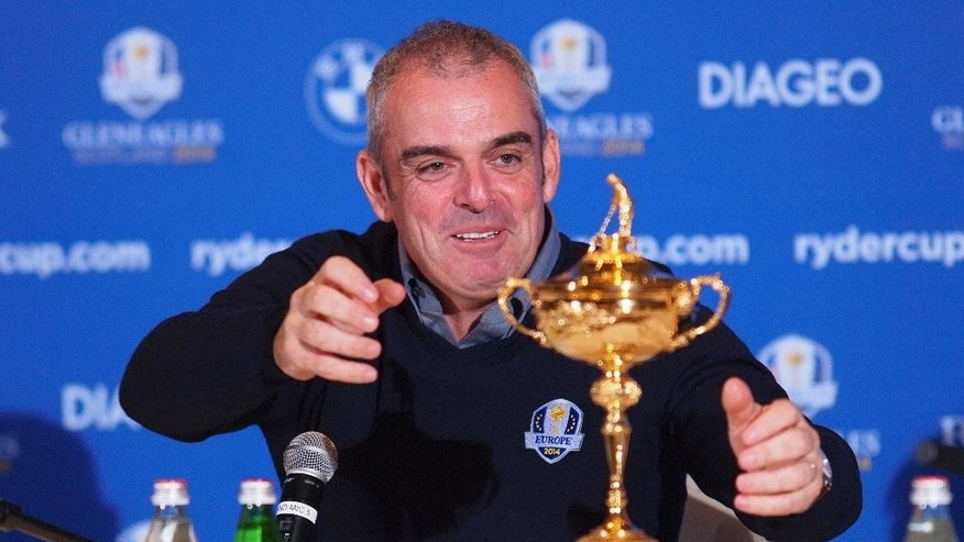 FILE - This is a Tuesday, Jan. 15, 2013  file photo of Paul McGinley of Ireland reaches for the trophy after being named as team  Captain for the 2014 European Ryder Cup Team following a meeting of the Tournament Committee of the European Tour in Abu Dhabi, United Arab Emirates. McGinley's will lead the European team against the U.S. at Gleneagles in Scotland for the  2014 Ryder Cup, starting Friday Sept 26, 2014.  The European team  has not lost at home in 20 years.  (AP Photp/Manuel Salazar, File)