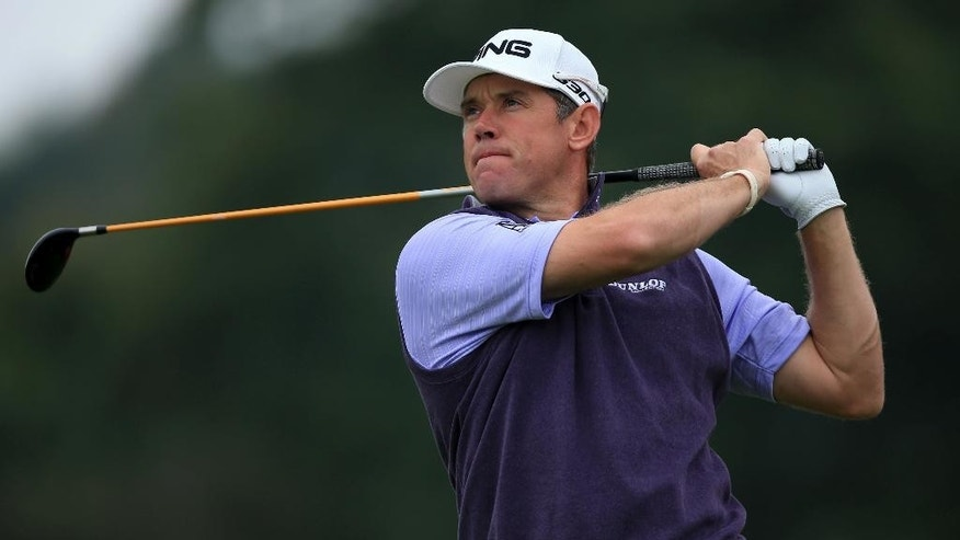 England's Lee Westwood tees off from on 6th during day two of the Wales Open golf tournament  at Celtic Manor, Newport Wales  Friday Sept. 19, 2014. (AP Photo/ Nick Potts/PA) UNITED KINGDOM OUT
