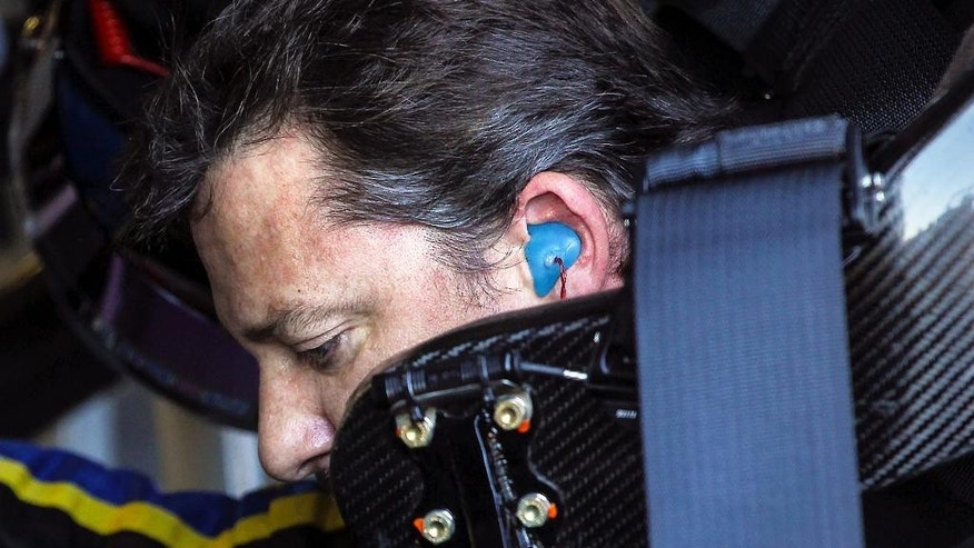 Driver Tony Stewart sits in his car gets as it gets serviced during practice for the NASCAR Sprint Cup auto race at New Hampshire Motor Speedway, Friday, Sept. 19, 2014, in Loudon, N.H. (AP Photo/Cheryl Senter)