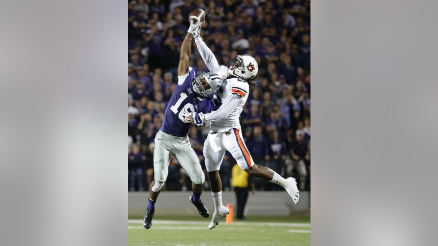 Auburn defensive back Trovon Reed (25) breaks up a pass intended for Kansas State wide receiver Tyler Lockett (16) during the second half of an NCAA college football game Thursday, Sept. 18, 2014, in Manhattan, Kan. Auburn won 20-14. (AP Photo/Charlie Riedel)