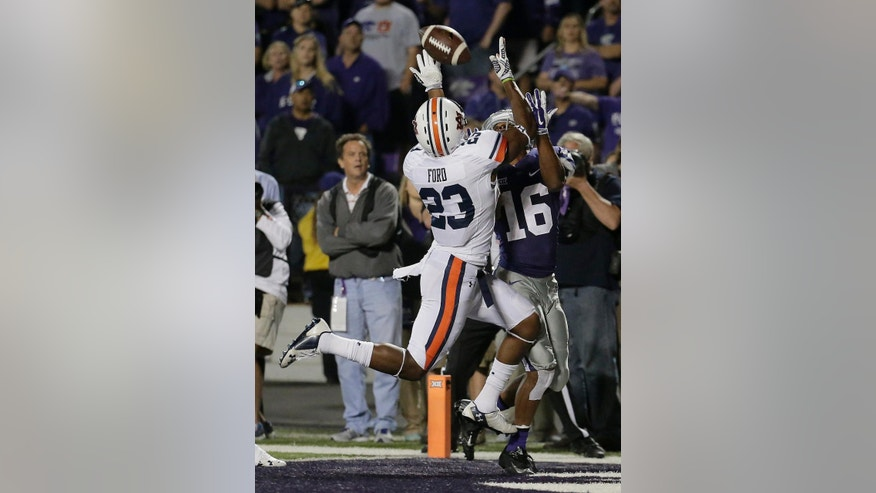 Auburn defensive back Johnathan Ford (23) breaks up a pass intended for Kansas State wide receiver Tyler Lockett (16) during the second half of an NCAA college football game Thursday, Sept. 18, 2014, in Manhattan, Kan. Auburn won 20-14. (AP Photo/Charlie Riedel)