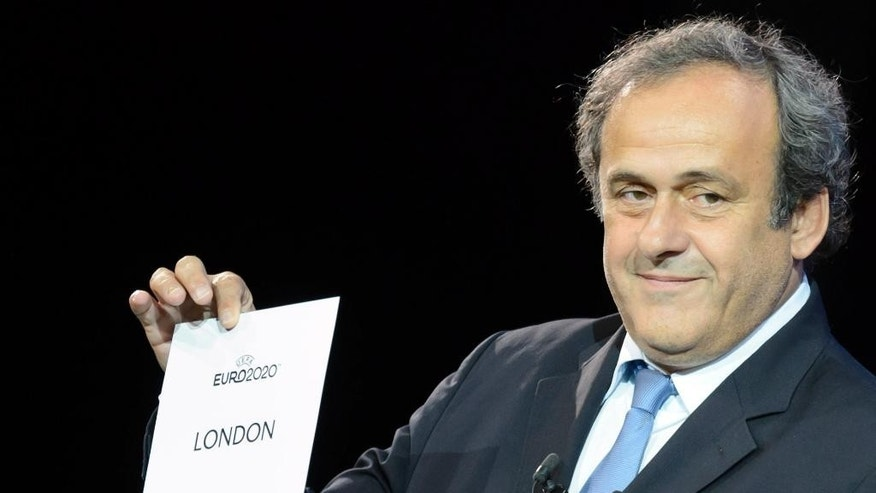 UEFA President Michel Platini announces that London will stage the final and semifials of the UEFA Euro 2020 European soccer championships, during the UEFA Euro 2020 Hosts Announcement Ceremony at the Espace Hippomene in Geneva, Switzerland, Friday, September 19, 2014. The UEFA Euro 2020  tournament will be held in thirteen cities in thirteen different European countries. (AP Photo/KEYSTONE/Salvatore Di Nolfi)