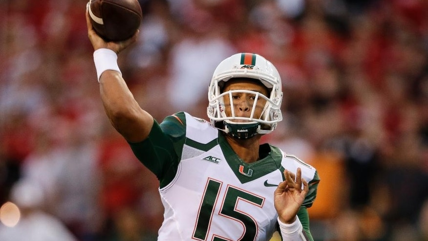 Miami quarterback Brad Kaaya (15) throws in the first half of an NCAA college football game against Nebraska in Lincoln, Neb., Saturday, Sept. 20, 2014. (AP Photo/Nati Harnik)