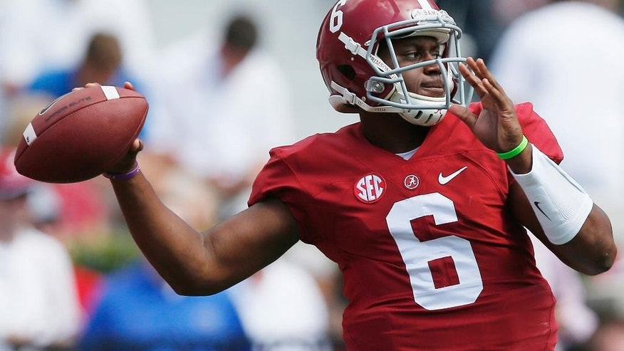 Alabama quarterback Blake Sims throws a pass as he warms up before an NCAA college football game against Florida, Saturday, Sept. 20, 2014, in Tuscaloosa, Ala. (AP Photo/Brynn Anderson)