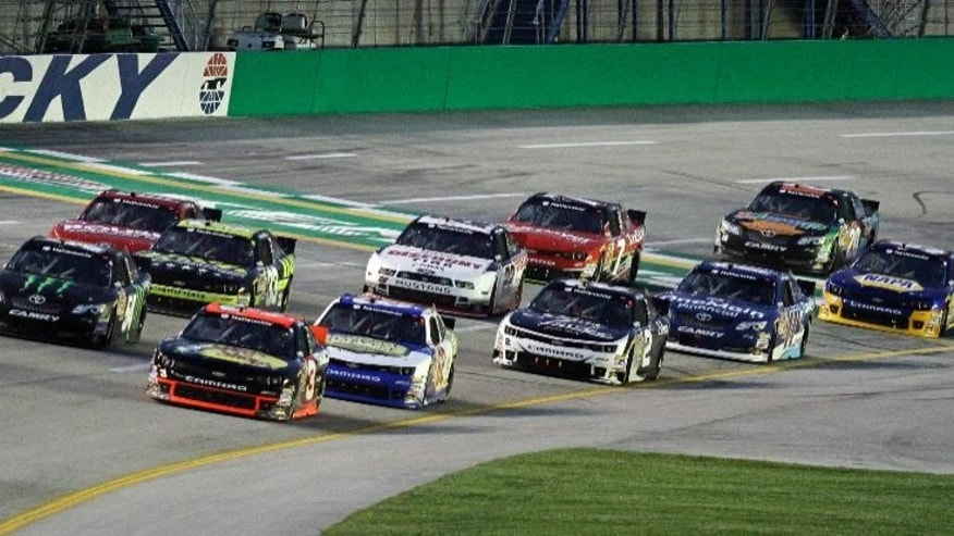 Pole-sitter Ty Dillon (3) leads at the start of the NASCAR Nationwide auto race in Sparta, Ky., Saturday, Sept. 20, 2014. Sam Hornish, Jr. (54) and Brendan Gaughan (62) stay close. (AP Photo/Garry Jones)