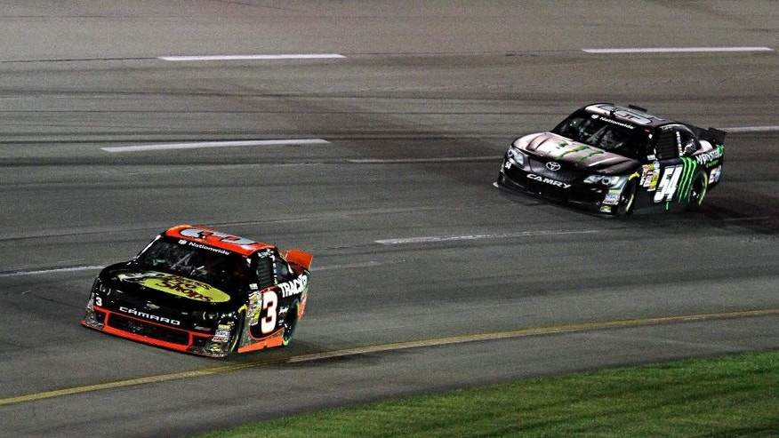 Driver Ty Dillon (3) opens a lead on Sam Hornish, Jr. (54) early in the NASCAR Nationwide auto race in Sparta, Ky., Saturday, Sept. 20, 2014. (AP Photo/Garry Jones)