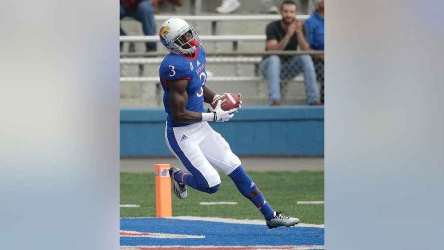 Kansas wide receiver Tony Pierson (3) runs into the end zone to score a touchdown during the first half of an NCAA college football game against Central Michigan  Saturday, Sept. 20, 2014, in Lawrence, Kan. (AP Photo/Charlie Riedel)