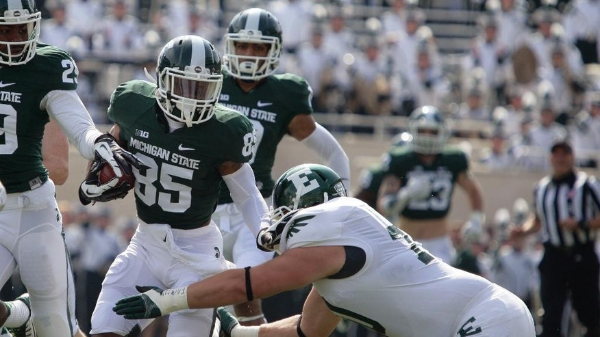 Michigan State's Macgarrett Kings Jr. (85) runs back a punt against Eastern Michigan's Matt Thornton during the first quarter of an NCAA college football game, Saturday, Sept. 20, 2014, in East Lansing, Mich. (AP Photo/Al Goldis)