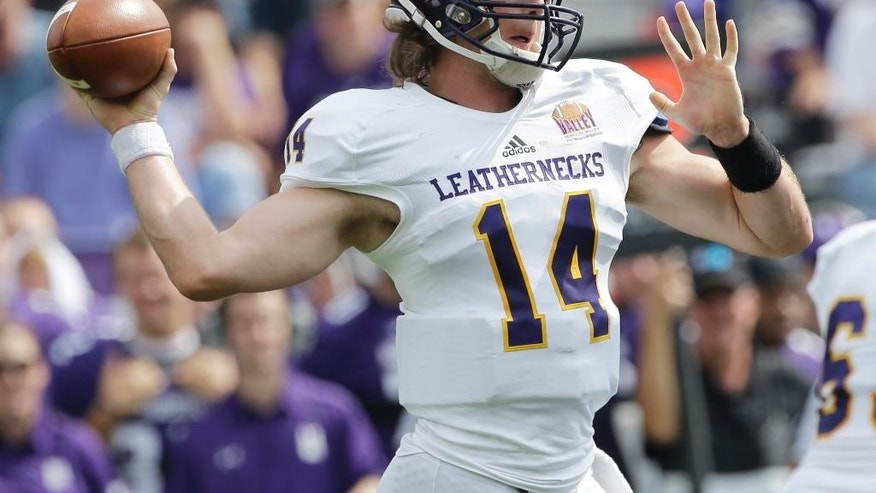 Western Illinois quarterback Trenton Norvell (14) looks to a pass during the first half of an NCAA college football game against Northwestern in Evanston, Ill., Saturday, Sept. 20, 2014. (AP Photo/Nam Y. Huh)