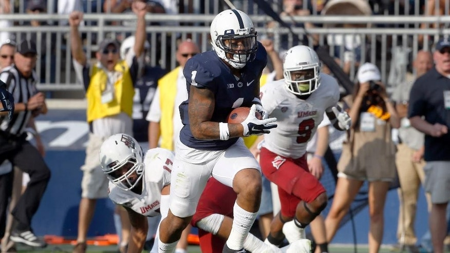 Penn State running back Bill Belton (1) runs past Massachusetts defensive back Trey Dudley-Giles (9) and linebacker Jovan Santos-Knox (17) on his way to a 24-yard touchdown run in the second quarter of the NCAA football game on Saturday, Sept. 20, 2014, in State College, Pa. (AP Photo/Keith Srakocic)