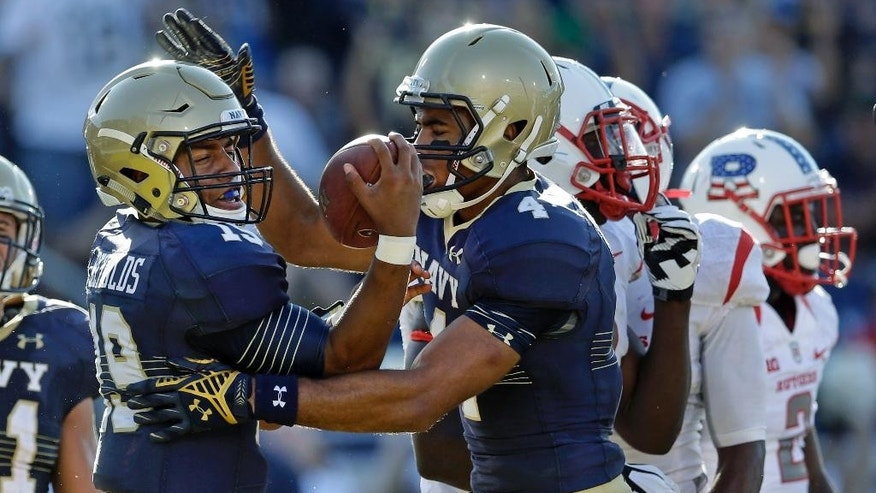 Navy quarterback Keenan Reynolds, left, celebrates his touchdown with teammate Jamir Tillman in the first half of an NCAA college football game against Rutgers in Annapolis, Md., Saturday, Sept. 20, 2014. (AP Photo/Patrick Semansky)