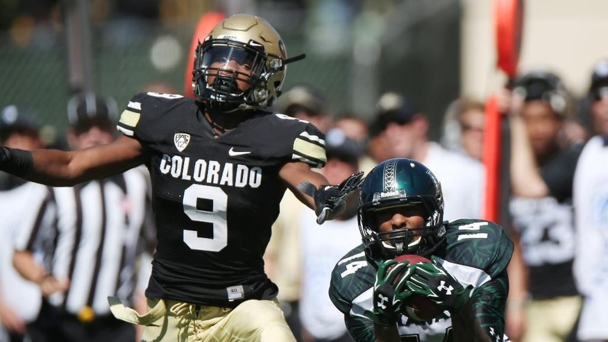 Hawaii wide receiver Marcus Kemp, right, pulls in pass as Colorado defensive back Tedric Thompson covers in the third quarter of an NCAA college football game in Boulder, Colo., on Saturday, Sept. 20, 2014. (AP Photo/David Zalubowski)