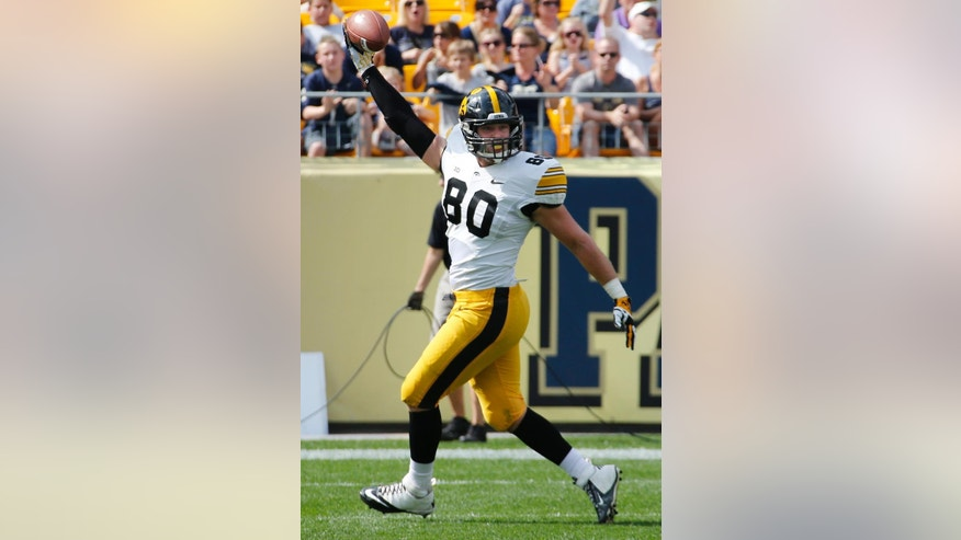 Iowa tight end Henry Krieger Coble (80) celebrates after catching a pass in the endzone for a first-quarter touchdown during an NCAA college football game against Pittsburgh in Pittsburgh, Saturday, Sept. 20, 2014. (AP Photo/Gene Puskar)