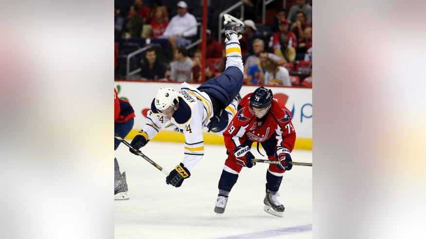 Buffalo Sabres left wing Vaclav Karabacek (74) goes over Washington Capitals left wing Nathan Walker (79) in the third period of a preseason NHL hockey game, Sunday, Sept. 21, 2014, in Washington. The Capitals won 1-0. (AP Photo/Alex Brandon)