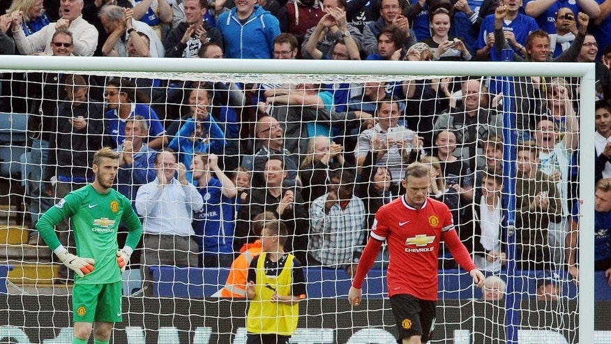 Manchester United players David De Gea, left, and Wayne Rooney react after Leicester's Jamie Vardy scored against Manchester United  during the English Premier League soccer match between Leicester City and Manchester United at King Power Stadium, in Leicester, England, Sunday, Sept. 21, 2014.  (AP Photo/Rui Vieira)