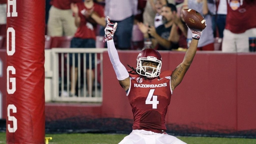 Arkansas wide receiver Keon Hatcher celebrates his fourth-quarter touchdown in an NCAA college football game against Northern Illinois in Fayetteville, Ark., Saturday, Sept. 20, 2014. Arkansas won 52-14. (AP Photo/Danny Johnston)