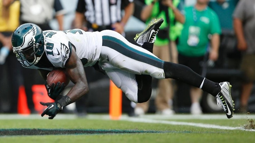 Philadelphia Eagles wide receiver Jeremy Maclin dives in for a touchdown on a pass from quarterback Nick Foles during the second half of an NFL football game against the Washington Redskins, Sunday, Sept. 21, 2014, in Philadelphia. (AP Photo/Michael Perez)