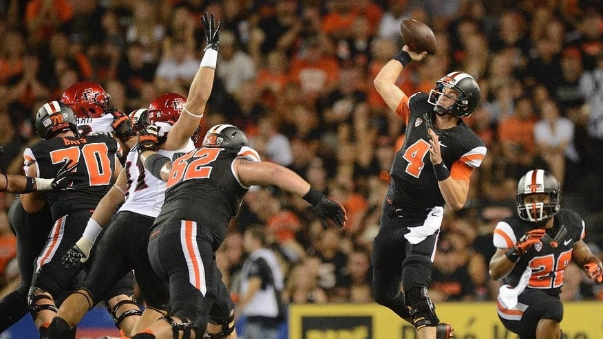 Oregon State quarterback Sean Mannion (4) passes against San Diego State during the first quarter of an NCAA college football game in Corvallis, Ore., Saturday, Sept. 20, 2014. (AP Photo/Troy Wayrynen)