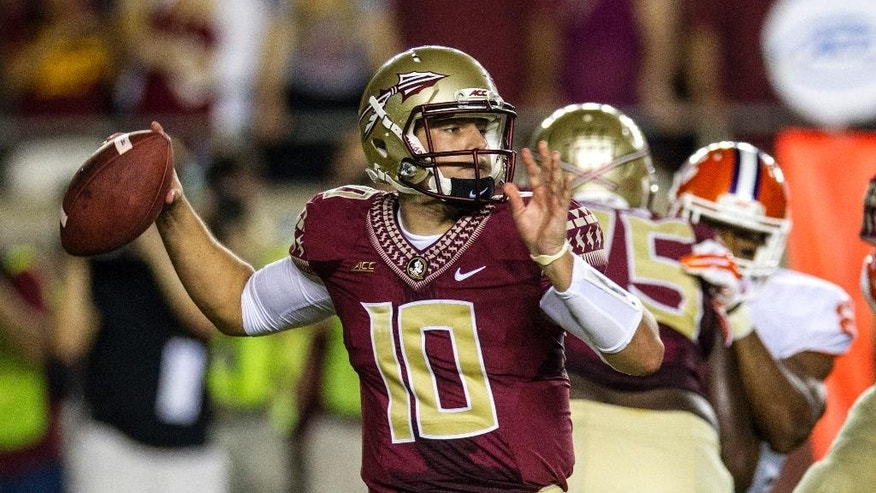 Florida State quarterback Sean Maquire throws a pass in the first half of an NCAA college football game against Clemson in Tallahassee, Fla., Saturday, Sept. 20, 2014. FSU quarterback Jameis Winston was suspended for the game. (AP Photo/Mark Wallheiser)