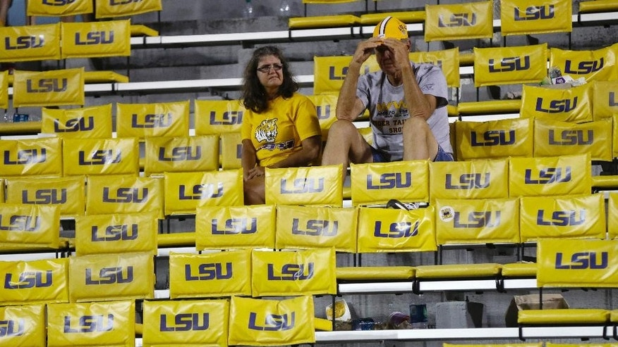 LSU fans sit dejected after their loss in an NCAA college football game against Mississippi State in Baton Rouge, La., Saturday, Sept. 20, 2014. LSU won 34-29. (AP Photo/Gerald Herbert)