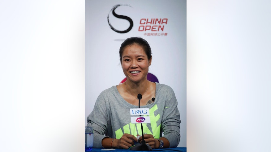 Chinese tennis player Li Na speaks to media during a press conference to announce her retirement in Beijing, China, Sunday, Sept. 21, 2014. The two-time Grand Slam champion from China who took tennis in Asia to a new level, has retired due to recurring knee injuries.  (AP Photo/Vincent Thian)