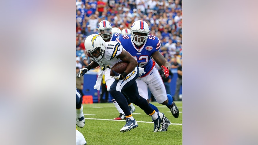 San Diego Chargers wide receiver Eddie Royal (11) breaks away from Buffalo Bills' Jarius Wynn (92) to score a touchdown during the first half of an NFL football game Sunday, Sept. 21, 2014, in Orchard Park, N.Y. (AP Photo/Bill Wippert)