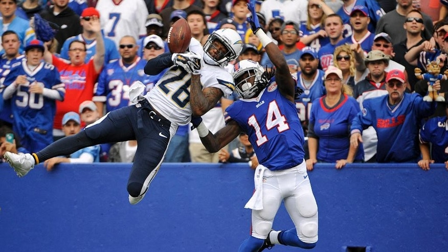 San Diego Chargers cornerback Brandon Flowers (26) breaks up a pass to Buffalo Bills wide receiver Sammy Watkins (14) during the first half of an NFL football game Sunday, Sept. 21, 2014, in Orchard Park, N.Y. (AP Photo/Gary Wiepert)