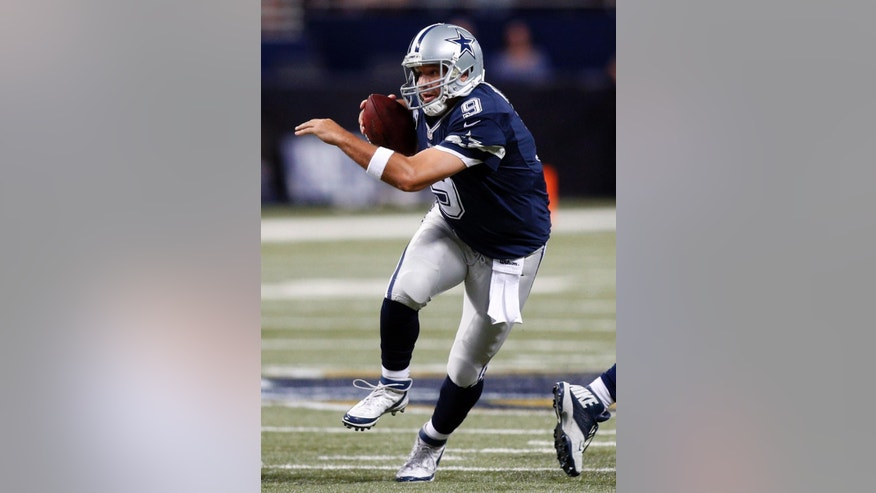 Dallas Cowboys quarterback Tony Romo scrambles during the second quarter of an NFL football game against the St. Louis Rams, Sunday, Sept. 21, 2014, in St. Louis. (AP Photo/Scott Kane)