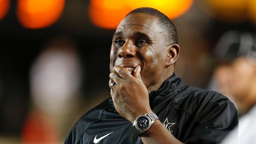 Vanderbilt head coach Derek Mason looks up at the scoreboard from the sideline during the second quarter of an NCAA college football game against South Carolina Saturday, Sept. 20, 2014, in Nashville, Tenn. (AP Photo/Mark Humphrey)