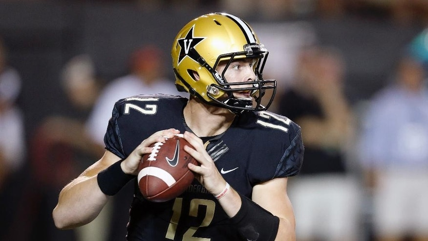 Vanderbilt quarterback Wade Freebeck passes against South Carolina during the second quarter of an NCAA college football game Saturday, Sept. 20, 2014, in Nashville, Tenn. (AP Photo/Mark Humphrey)