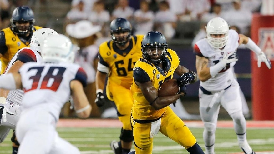 California wide receiver Darius Powe (10) runs with the ball after a reception against Arizona during the first half of an NCAA college football game, Saturday, Sept. 20, 2014, in Tucson, Ariz. (AP Photo/Rick Scuteri)