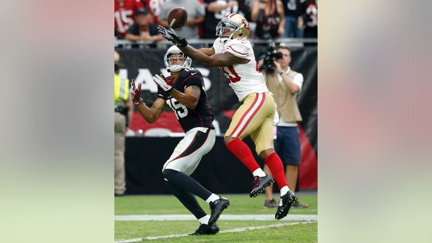 San Francisco 49ers cornerback Perrish Cox (20) breaks up a pass intended for Arizona Cardinals wide receiver Michael Floyd (15) during the second half of an NFL football game, Sunday, Sept. 21, 2014, in Glendale, Ariz. (AP Photo/Ross D. Franklin)