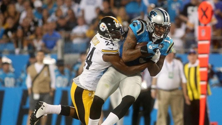 Carolina Panthers' Kelvin Benjamin (13) is brought down by Pittsburgh Steelers' Ike Taylor during an NFL football game Sunday, Sept. 21, 2014, in Charlotte, N.C. (AP Photo/The Star, Ben Earp)