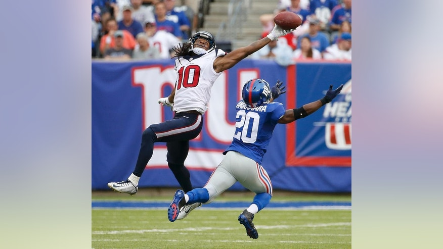 Houston Texans wide receiver DeAndre Hopkins (10) pulls in a pass against New York Giants cornerback Prince Amukamara (20) in the second quarter of an NFL football game, Sunday, Sept. 21, 2014, in East Rutherford, N.J. (AP Photo/Kathy Willens)