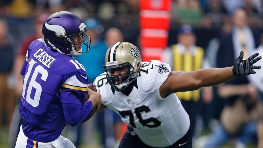Minnesota Vikings quarterback Matt Cassel (16) is pressured by New Orleans Saints defensive end Akiem Hicks (76) in the first half of an NFL football game in New Orleans, Sunday, Sept. 21, 2014. (AP Photo/Rogelio Solis)