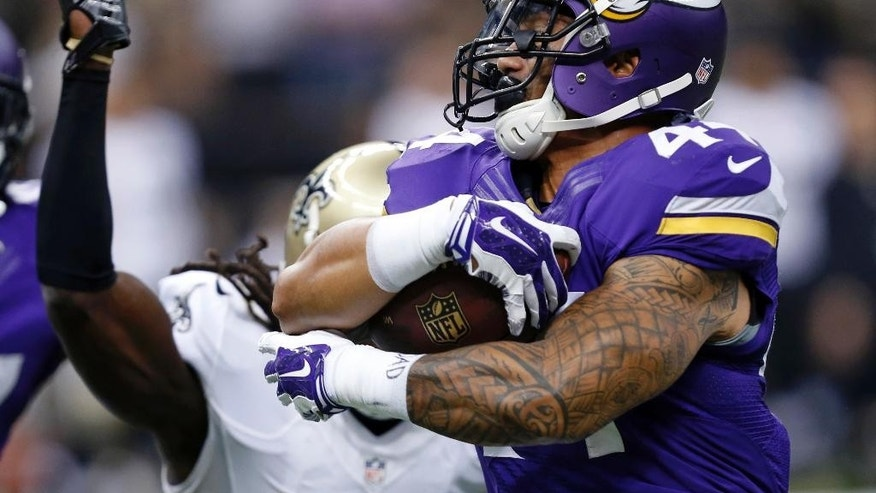 Minnesota Vikings running back Matt Asiata (44) carries the ball past New Orleans Saints defensive back A.J. Davis (20) in the first half of an NFL football game in New Orleans, Sunday, Sept. 21, 2014. (AP Photo/Rogelio Solis)