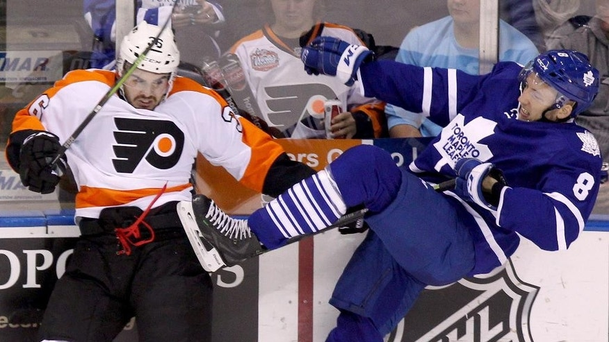 Toronto Maple Leafs Petter Granberg, right,  is hit by Philadelphia Flyers Zac Rinaldo during first period NHL pre-season action, Monday, Sept. 22, 2014 in London, Ontario. (AP Photo/The Canadian Press, Dave Chidley)