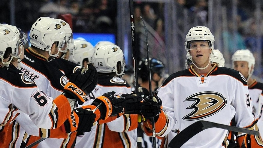 Anaheim Ducks left wing Brad Winchester, right, celebrates a goal with his teammates in the first period of an NHL preseason hockey game against the Colorado Avalanche Monday, Sept. 22, 2014 in Denver. (AP Photo/Chris Schneider)