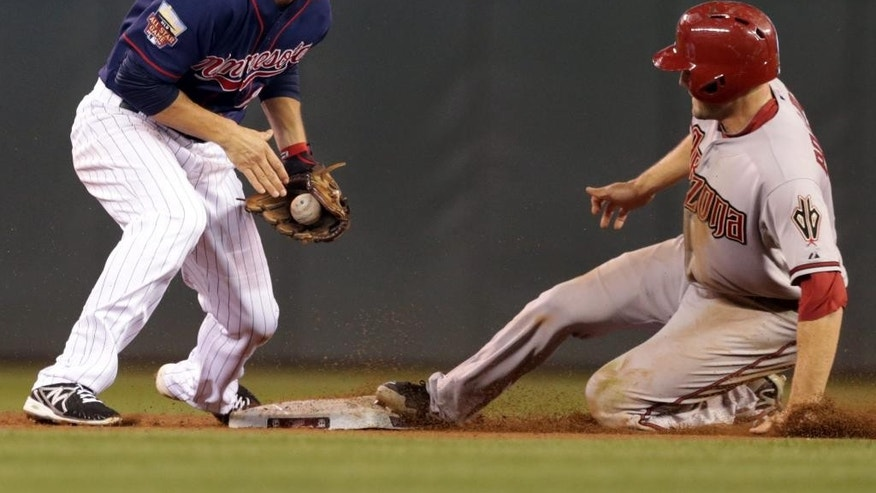 Arizona Diamondbacks' A.J. Pollock, right, steals second base on Minnesota Twins second baseman Doug Bernier in the fifth inning of a baseball game, Monday, Sept. 22, 2014, in Minneapolis. (AP Photo/Jim Mone)