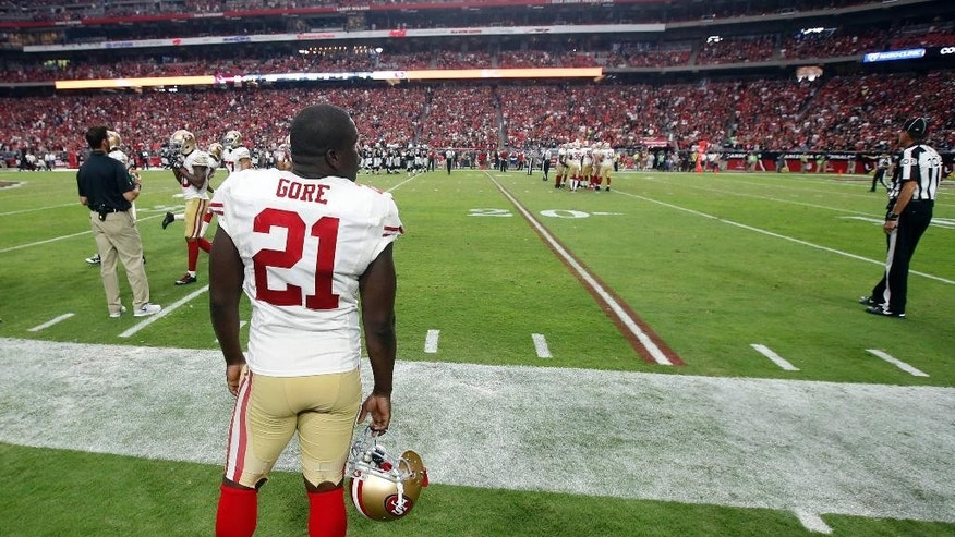 San Francisco 49ers running back Frank Gore watches from the sidelines during the second half of the 49ers' NFL football game against the Arizona Cardinals, Sunday, Sept. 21, 2014, in Glendale, Ariz. The Cardinals won 23-14. (AP Photo/Ross D. Franklin)