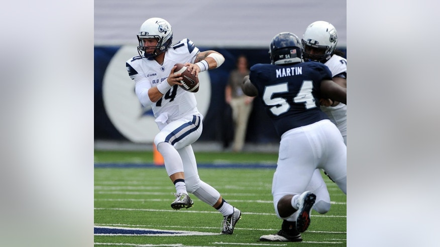 Old Dominion quarterback Taylor Heinicke, left, scrambles during the second half against Rice during an NCAA college football game Saturday, Sept. 20, 2014, in Houston. (AP Photo/Houston Chronicle, Eric Christian Smith)