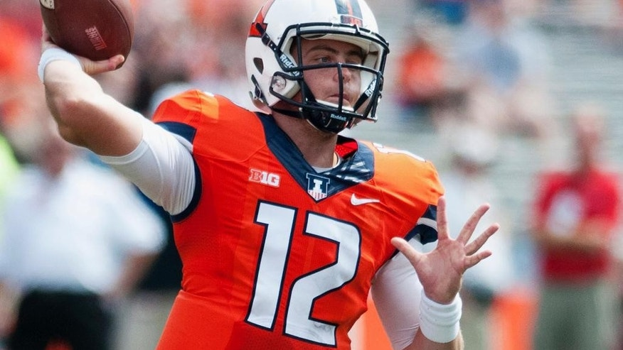 FILE - In this Aug. 30, 2014, file photo, Illinois quarterback Wes Lunt throws the ball in the second half of an NCAA college football game against Youngstown State in Champaign, Ill. This season Lunt looks like two different quarterbacks in the first and second halves. He struggles to find receivers in the first half and in the second half he is a strong-armed game-saver who finds receivers downfield for touchdowns, delivering well over 200 yards a half and three comeback wins. (AP Photo/Bradley Leeb, File)